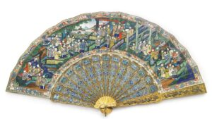A Chinese export silver-gilt and enamel fan, second half of 19th century, 28.6cm long. Photograph © Sotheby's.