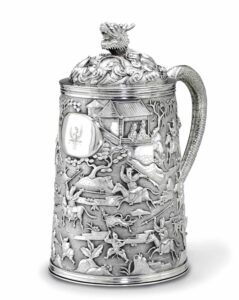 A Chinese export silver tankard and cover, mark of KHE Cheong, Canton, 1820-1890, 19cm high. Photograph © Christies.