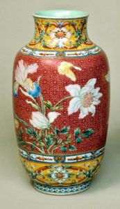 A famille rose sgraffiato ground flower vase, Qianlong mark and period, Victoria and Albert Museum, Salting Bequest.