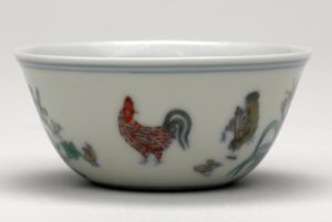 A blue and white doucai 'chicken' cup, Chenghua mark and period, 8.3cm diameter, Percival David Collection, British Museum.