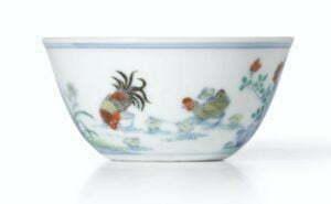 A doucai 'chicken' cup, Yongzheng mark and period, 8cm diameter.