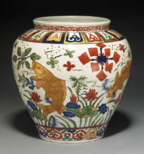 A Wucai 'fish' jar, Jiajing mark and period, 24cm high, British Museum, Henry J Oppenheim Bequest, 1947.