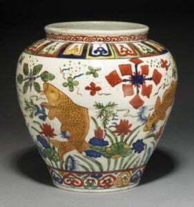 A Wucai 'fish' jar, Jiajing mark and period, 24cm high, British Museum, Henry J Oppenheim Bequest, 1947.