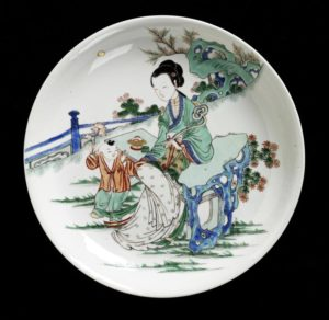 A famille verte dish, Qing dynasty, Kangxi period, 27cm diameter, Victoria and Albert Museum, Mr Andrew Burman Bequest.