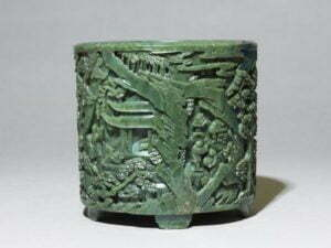 'Spinach' jade brushpot, Qing Dynasty, Qianlong Period, 16.5cm high.Ashmolean Museum, Presented by Mrs Fraser, in memory of her mother Mrs Margaret F. Jenkins, 1967.